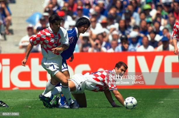 Japan's Shoji Jo can't find a way past Croatia's Aljosa Asanovic and Krunoslav Jurcic