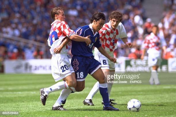 Japan's Shoji Jo takes on Croatia's Dario Simic and Slaven Bilic