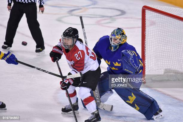 Japan's Shoko Ono stands in front of Sweden's Sara Grahn in the women's classifications ice hockey match between Sweden and Japan during the...