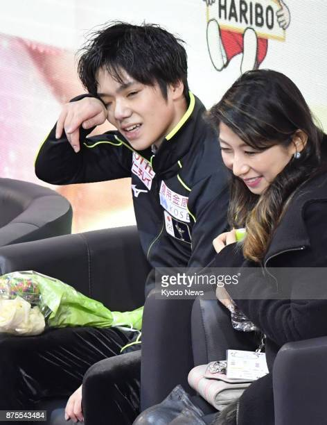 Japan's Shoma Uno and his coach Mihoko Higuchi wait for his score for the men's short program at the Internationaux de France the fifth event of the...
