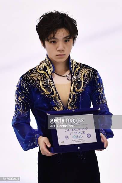 Japan's Shoma Uno poses during the Senior Men free skating long program victory ceremony during the 10th edition of the Lombardia Trophy 2017 in the...