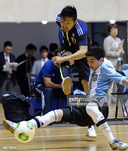 Japan s Shota Hoshi shoots the ball beside Argentina s Martin Lombardi  during their friendly futsal match in 1e01898432d86
