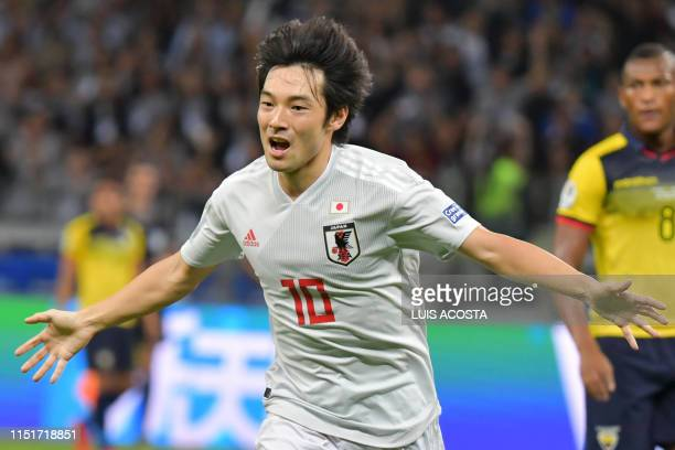Japan's Shoya Nakajima celebrates after scoring against Ecuador during their Copa America football tournament group match at the Mineirao Stadium in...
