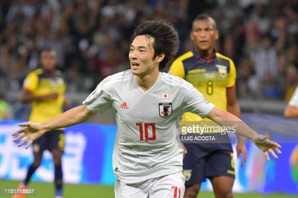 TOPSHOT Japan's Shoya Nakajima celebrates after scoring against Ecuador during their Copa America football tournament group match at the Mineirao...