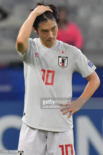 Japan's Shoya Nakajima gestures after tying 11 with Ecuador and not reaching the quarterfinals of the Copa America football tournament group match at...