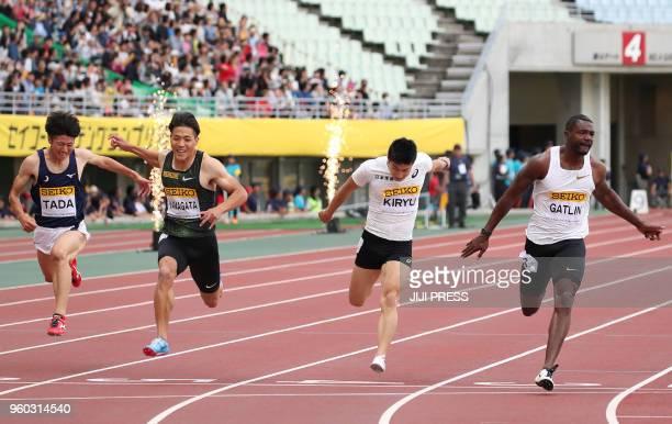 Japan's Shuhei Tada, Ryota Yamagata, Yoshihide Kiryu and USA's Justin Gatlin compete during the men's 100m event of the Golden Grand Prix athletics...