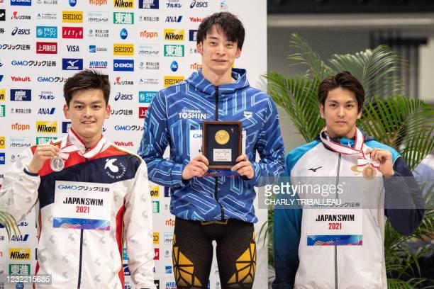 Japan's silver medalist Kohei Hosokawa , gold medalist Ryosuke Irie and bronze medalist Junya Koga pose after competing in the men's 50m backstroke...