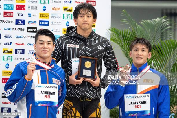 Japan's silver medalist Naoki Mizunuma , bronze medalist Yuya Tanaka and gold medalist Takeshi Kawamoto pose after competing in the men's 50m...