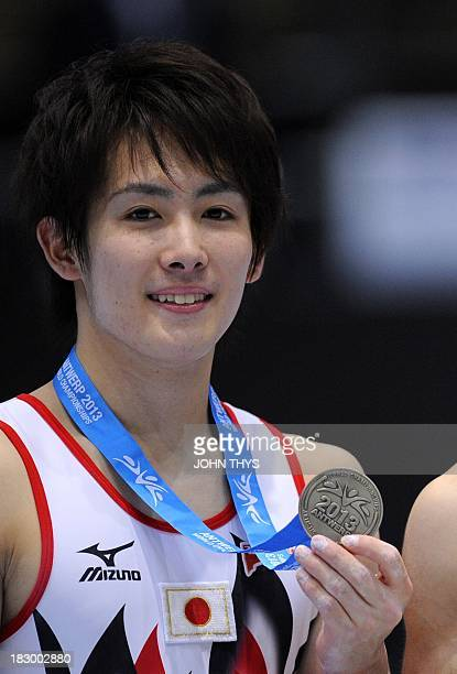 Japan's silver medalist Ryohei Kato celebrates on the podium after the men's allaround final during the 44th World Artistic Gymnastics Championships...