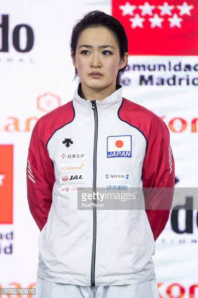 Japan's silver medallist Kiyou Shimizu pose on the podium after the Kata individual female competition during the 24th Karate World Championships at...