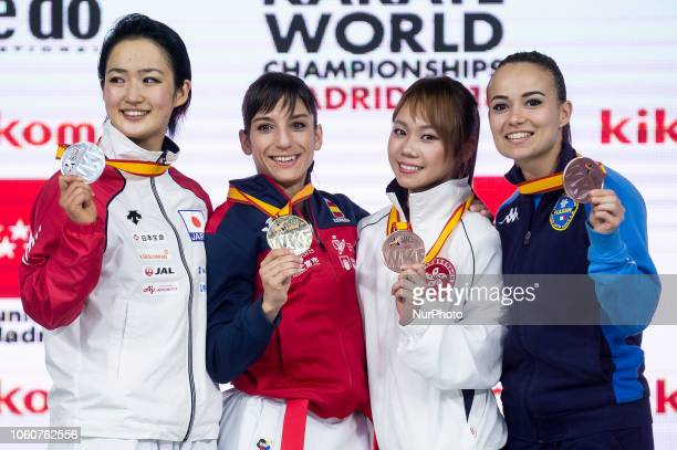 Japan's silver medallist Kiyou Shimizu Spain's gold medallist Sandra Sanchez Jaime and bronze medallists Hong Kong's Mo Sheung Grace Lau and Italy's...