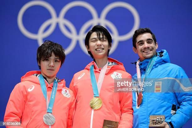 Japan's silver medallist Shoma Uno, Japan's gold medallist Yuzuru Hanyu and Spain's bronze medallist Javier Fernandez pose on the podium during the...