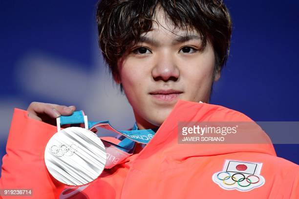 Japan's silver medallist Shoma Uno poses on the podium during the medal ceremony for the figure skating Men's singles event at the Pyeongchang Medals...