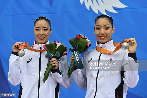 Japan's silver medallists Risako Mitsui and Yukiko Inui pose with their medals after the final of the duets free routine synchronised swimming event...