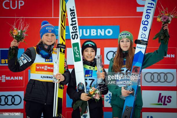 Japan's ski jumper Sara Takanashi celebrates her victory flanked by secondplaced Norway's ski jumper Maren Lundby and thirdplaced Germany's ski...