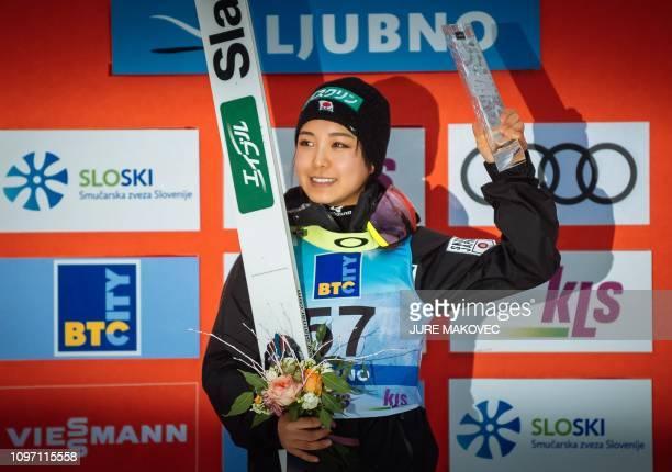 Japan's ski jumper Sara Takanashi celebrates on the podium after winning the FIS Ladies Ski Jumping World Cup Normal Hill Individual in Ljubno...