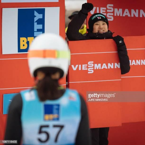 Japan's ski jumper Sara Takanashi is congratulated by Japan's skier Yuki Ito after winning the FIS Ladies Ski Jumping World Cup Normal Hill...