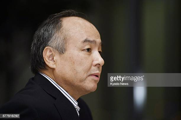 Japan's SoftBank Group Corp Chief Executive Officer Masayoshi Son is interviewed by the media in Tokyo on July 19 a day after Softbank announced it...