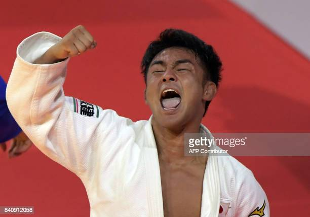 Japan's Soichi Hashimoto celebrates his victory over Azerbaian's Rustam Orujov after their final in the mens 73kg category at the World Judo...