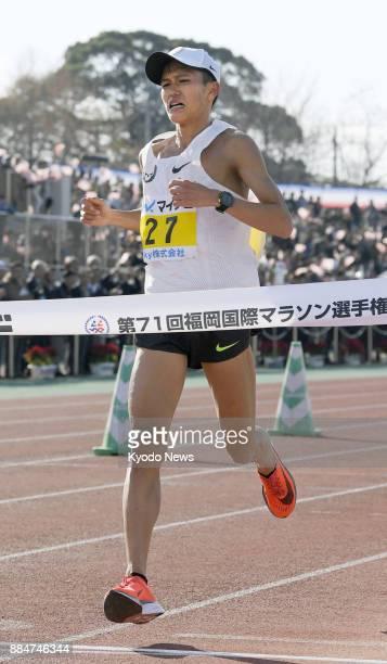 Japan's Suguru Osako crosses the finish line for third place at the Fukuoka International Marathon at Heiwadai Athletic Stadium in Fukuoka on Dec 3...