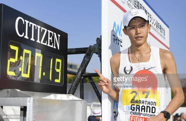 Japan's Suguru Osako poses at Heiwadai Athletic Stadium in Fukuoka on Dec 3 after finishing third at the Fukuoka International Marathon with a time...
