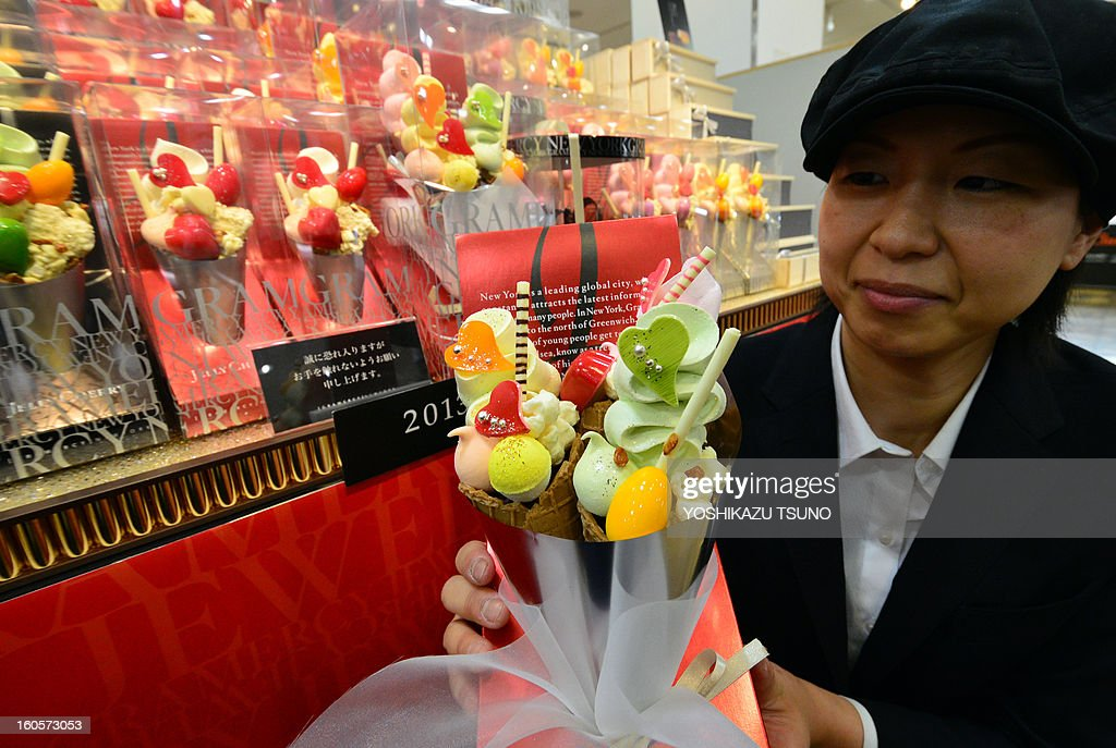Japan's sweet shop Gramercy New York sales clerk displays icecream corn shaped chocolates 'Jelly Cherry' at Takashimaya department store's Valentine's Day event 'Amour du Chocolat' in Tokyo on February 3, 2013. Japanese women feel the need to give chocolate to their boyfriends, work colleagues and teachers on February 14 as a social obligation more than a sign of love. AFP PHOTO / Yoshikazu TSUNO