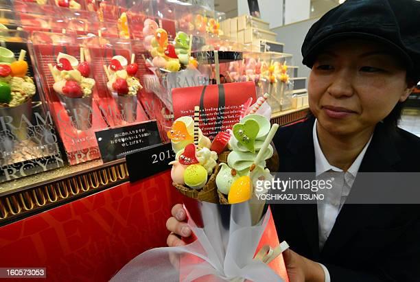 Japan's sweet shop Gramercy New York sales clerk displays icecream corn shaped chocolates 'Jelly Cherry' at Takashimaya department store's...