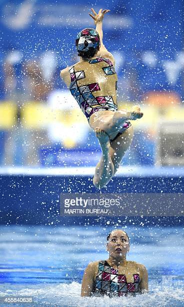 Japan's swimmers compete in the team technical routine synchronised swimming event during the 2014 Asian Games at the Munhak Park Taehwan Aquatics...