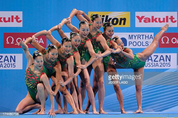 Japan's synchronised swimming team compete in the team free routine final during the synchronised swimming competition in the FINA World...