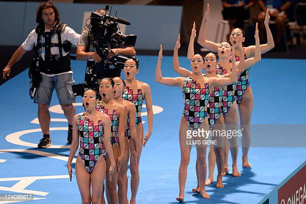 Japan's synchronised swimming team compete in the technical teams preliminary round during the synchronised swimming competition in the FINA World...