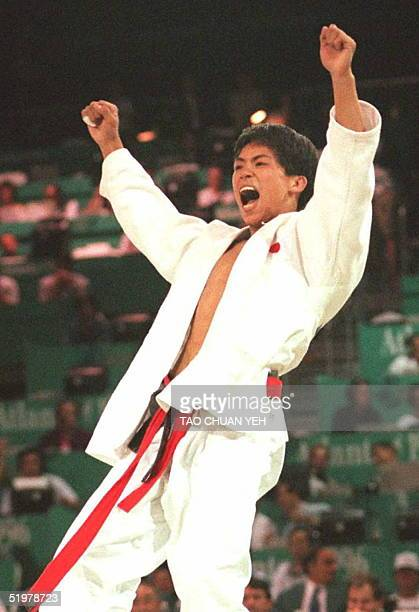 Japan's Tadahiro Nomura celebrates after defeating Italy's Giraliomo Giovinazzo 26 July to win the gold medal in the Olympic judo 60kg division at...