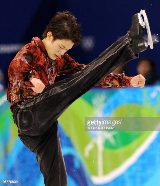 Japan's Takahiko Kozuka competes in the men's 2010 Winter Olympics figure skating short program at the Pacific Coliseum in Vancouver on February 16...