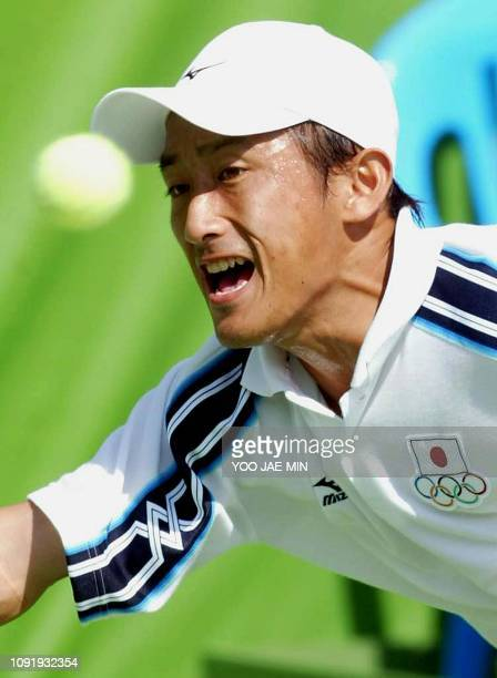 Japan's Takahiro Terachi goes for the ball during the second singles match against South Korea's Lee Hyungtaik in the men's team tennis final at the...