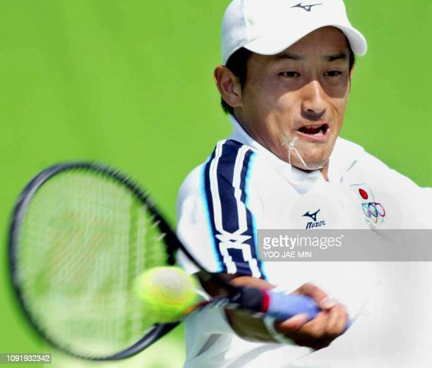 Japan's Takahiro Terachi returns a shot against South Korea's Lee Hyungtaik during the second singles match of the men's team tennis final at the...