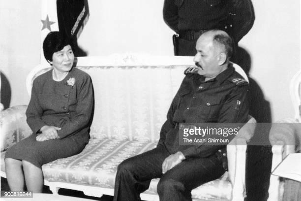 Japan's Takako Doi and Iraq Vice President Taha Yassin Ramadan talk as the gulf crisis escalates on January 13 1991 in Baghdad Iraq