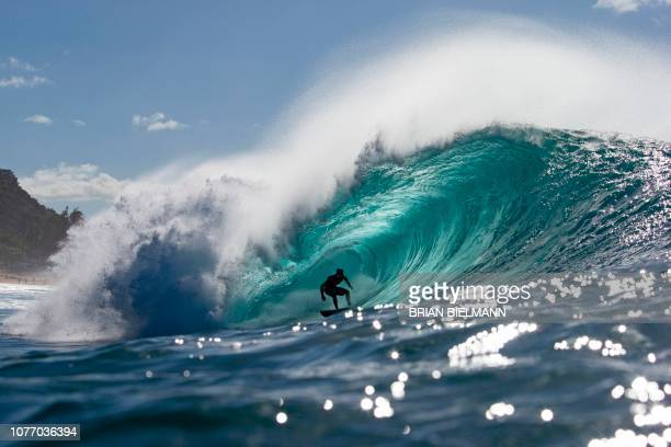 Japan's Takayuki Wakita surfs while practicing for Da Hui Backdoor shootout at the Pipeline Masters on Oahu's North Shore Hawaii on January 2 2019...