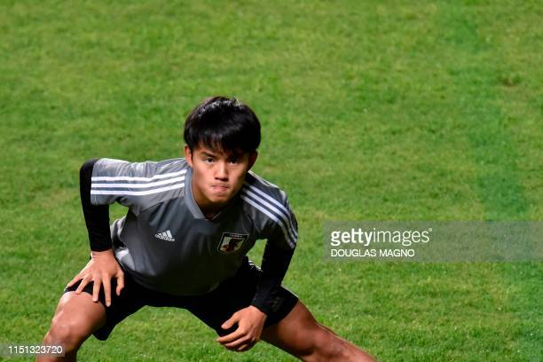 Japan's Takefusa Kubo stretches during a training session of the national team at the Independencia stadium, in Belo Horizonte, Brazil, on June 21...