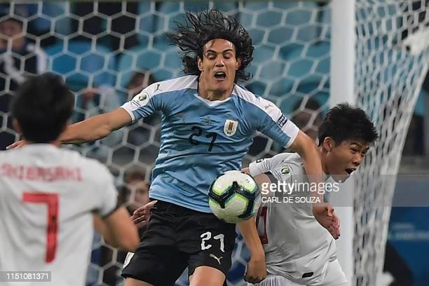 TOPSHOT Japan's Takehiro Tomiyasu and Uruguay's Edinson Cavani battle for the ball during the Copa America football tournament Group C match between...