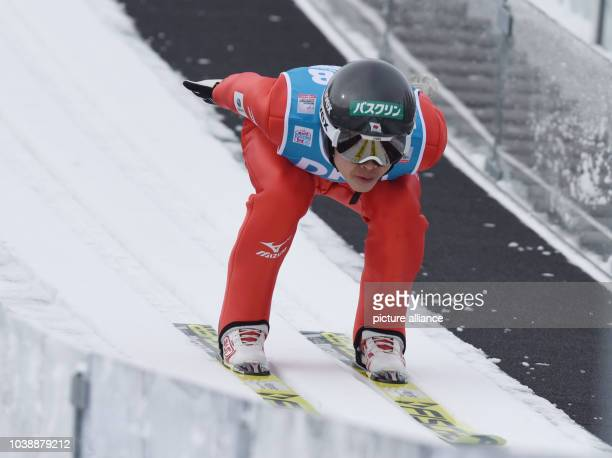Japan's Takehiro Watanabe in action during the trial round of the ski jumping segment at the team event of the Nordic Combined World Cup in Schonach...