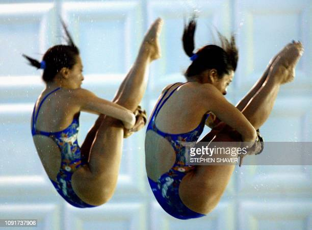 Japan's Takiri Miyazaki and Emi Otsuki perform in the women's synchronized diving finals 09 October 2002 during the 14th Asian Games in Busan China...