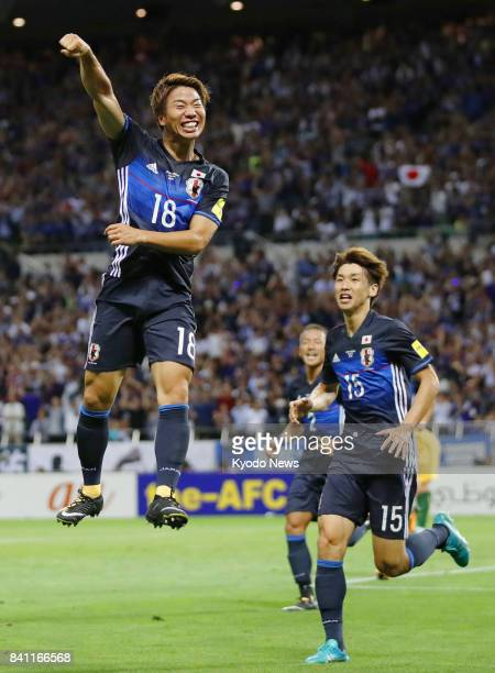 Japan's Takuma Asano celebrates after scoring the opener against Australia in the first half of a World Cup finalround qualifier at Saitama Stadium...
