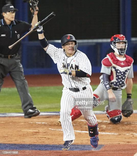 Japan's Takuya Kai reacts after hitting the game-winning hit against the United States in the 10th inning of their Tokyo Olympic second-round game at...