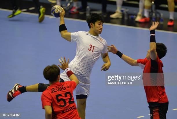 Japan's Tatsuki Yoshino attempts a goal against South Korea during the men's handball preliminary group B match between South Korea and Japan at the...