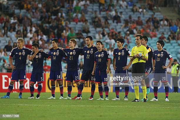 Japan's team wait for captain Makoto Hasebe to take his penatly kick against UAE at Stadium Australia Sydney Australia Friday 23rd January 2015