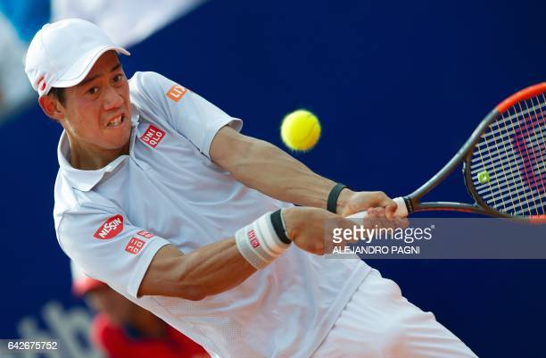 Japan's tennis player Kei Nishikori returns the ball to Argentina's Carlos Berlocq during their Argentina Open semifinal singles match at the Lawn...