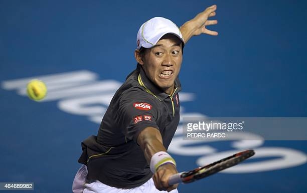 Japan's tennis player Kei Nishikori returns the ball to South Africa's tennis player Kevin Anderson during their Mexico ATP Open men's singles...