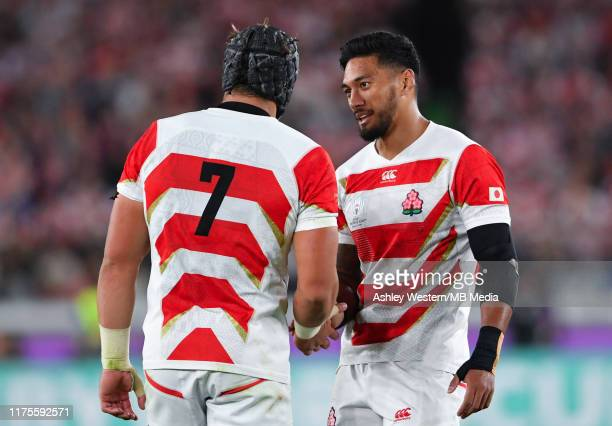 Japan's Timothy Lafaele with Pieter Labuschagne during the Rugby World Cup 2019 Group A game between Japan and Scotland at International Stadium...