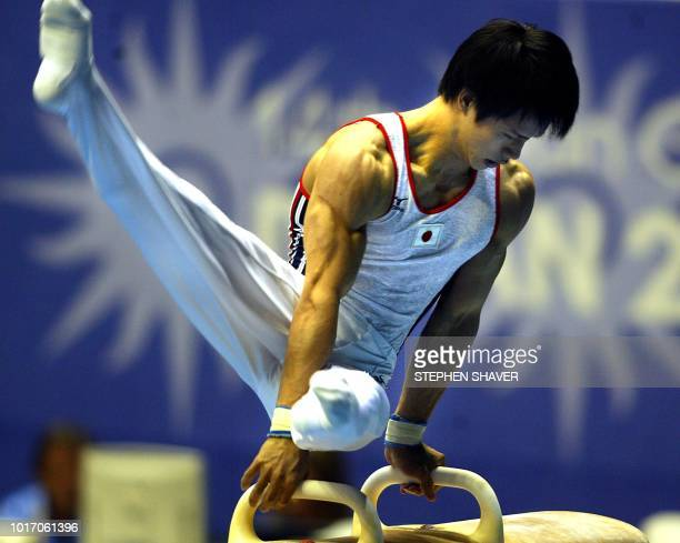 Japan's Tomita Hiroyuki, his country's top individual scorer, performs on the horse during the Artistic Gymnastics Men's Team Finals 01 October 2002...