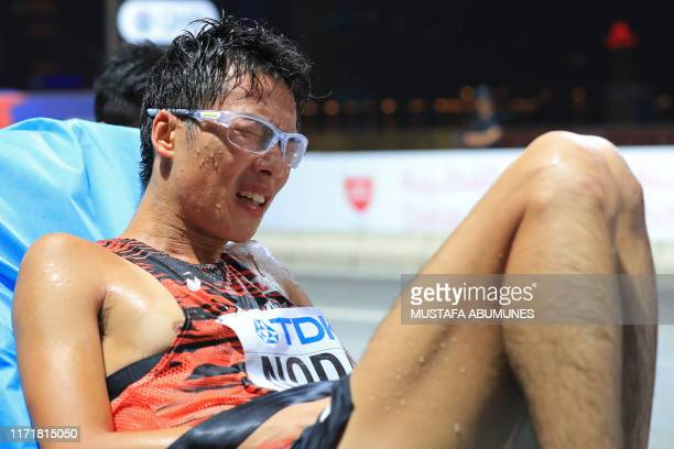 Japan's Tomohiro Noda reacts as he receives medical attention in the Men's 50km Race Walk final at the 2019 IAAF World Athletics Championships in...