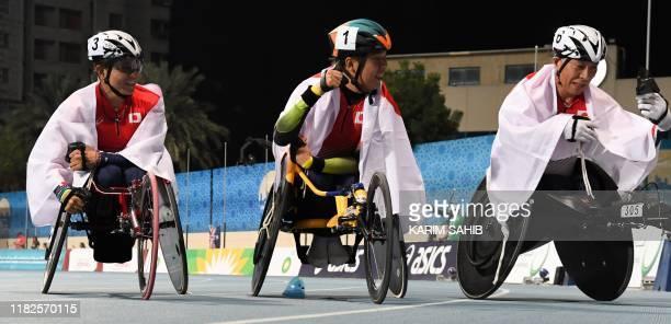 Japan's Tomoki Sato Hirokazu Ueyonabaru and Tomaya Ito celebrate after winning the men's 1500 meters T52 during the World Para Athletics...
